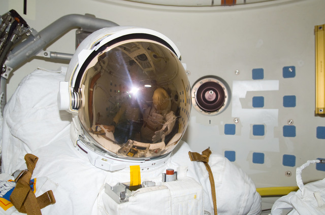 S113E05530 - STS-113 - Lopez-Alegria's reflection in EMU visor as he takes a photograph during STS-113