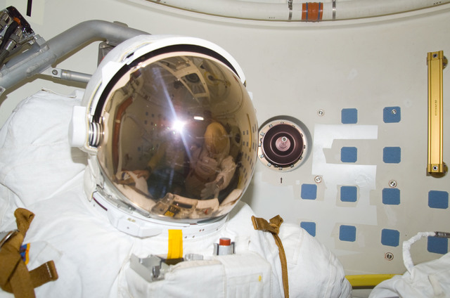 S113E05531 - STS-113 - Lopez-Alegria's reflection in EMU visor as he takes a photograph during STS-113