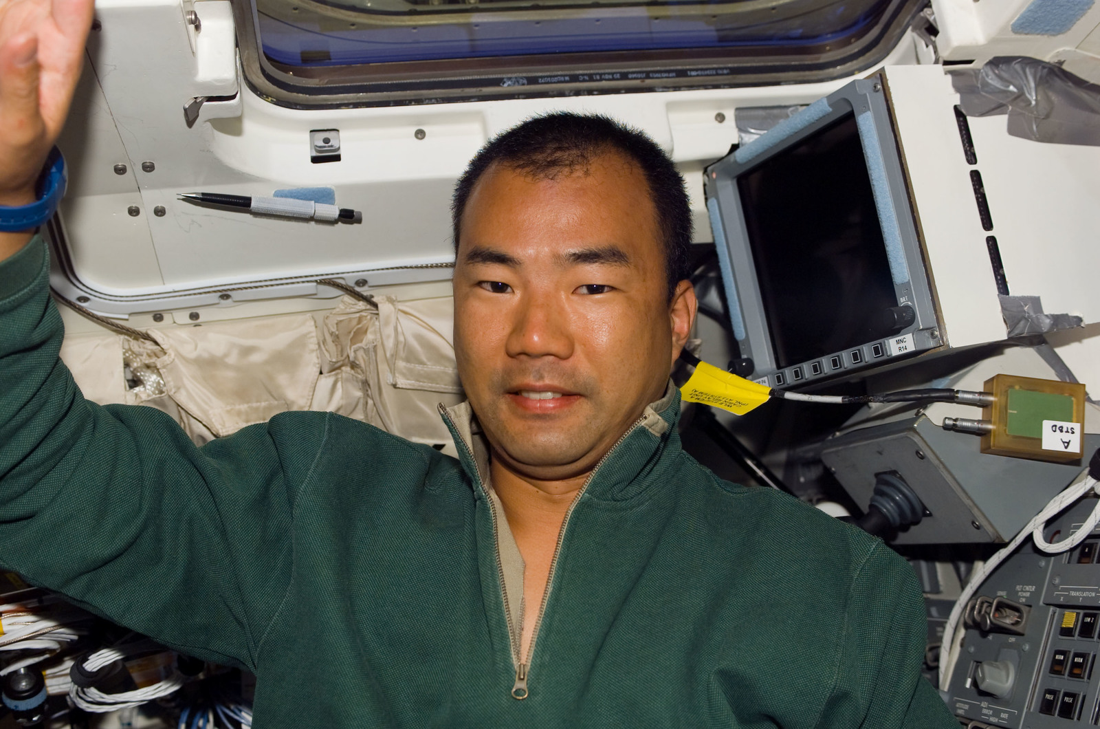 S114E5191 - STS-114 - STS-114 Mission specialist Soichi Noguchi on flight deck with drink packet
