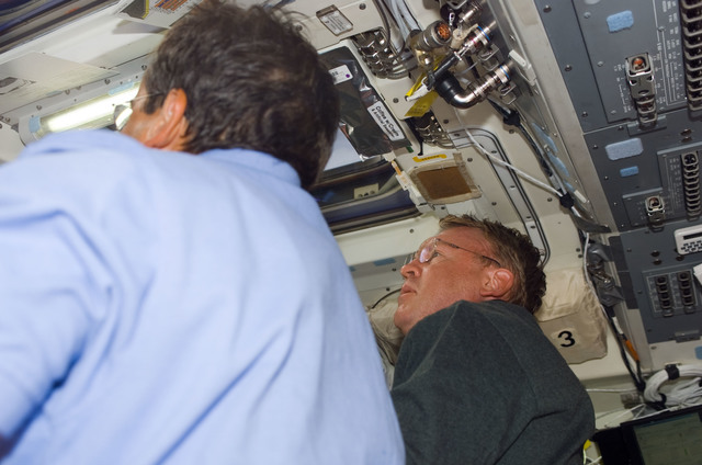 S114E5214 - STS-114 - STS-114 Mission specialists Thomas and Camarda on aft flight deck.