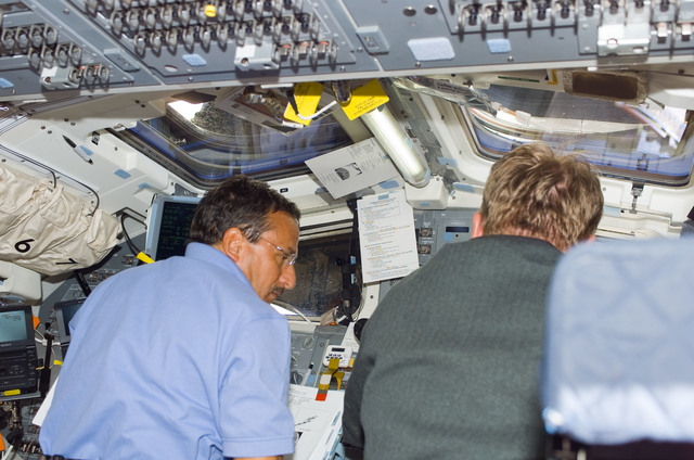 S114E5215 - STS-114 - STS-114 Mission specialists Thomas and Camarda on aft flight deck.