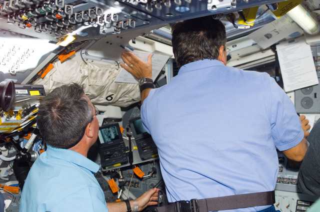 S114E5219 - STS-114 - STS-114 Mission specialists Robinson and Camarda on aft flight deck.