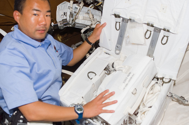 S114E5749 - STS-114 - Soichi Noguchi with tool kit