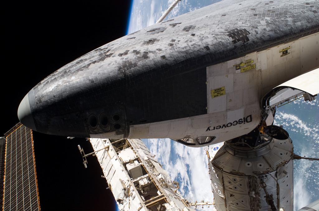 S114E6442 - STS-114 - Tile survey seen during EVA 3