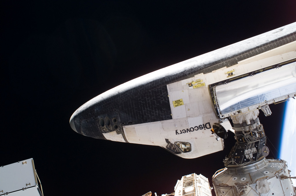 S114E6464 - STS-114 - Tile survey seen during EVA 3