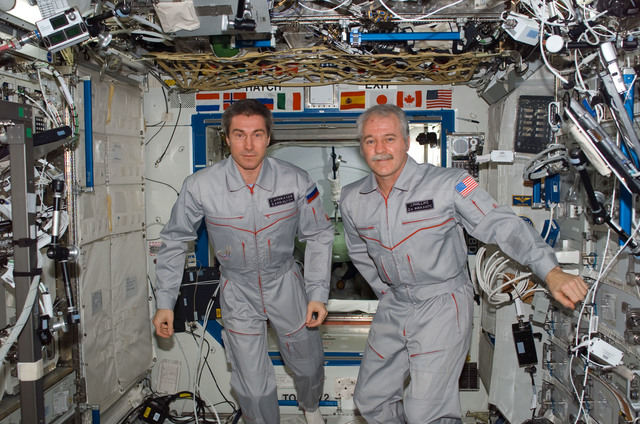 S114E6784 - STS-114 - Expedition 11 Crew in U.S. Laboratory