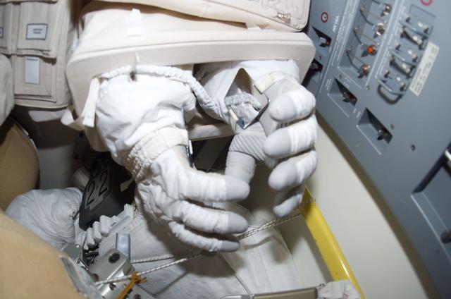 S114E6993 - STS-114 - EMU gloves in airlock