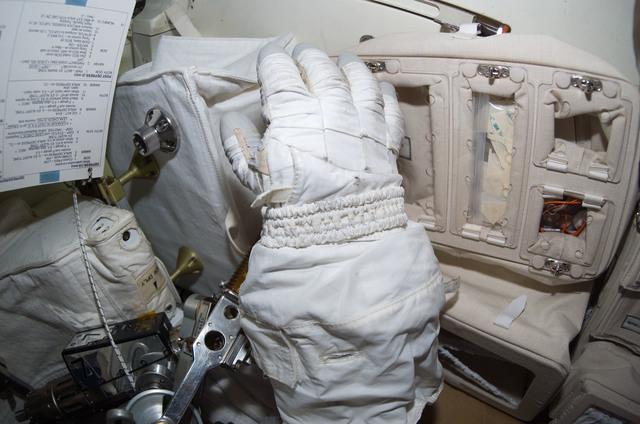 S114E6994 - STS-114 - EMU gloves in airlock