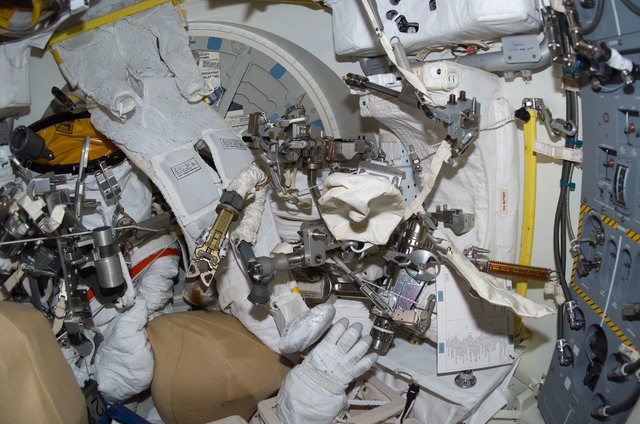 S114E6997 - STS-114 - EMU gloves in airlock