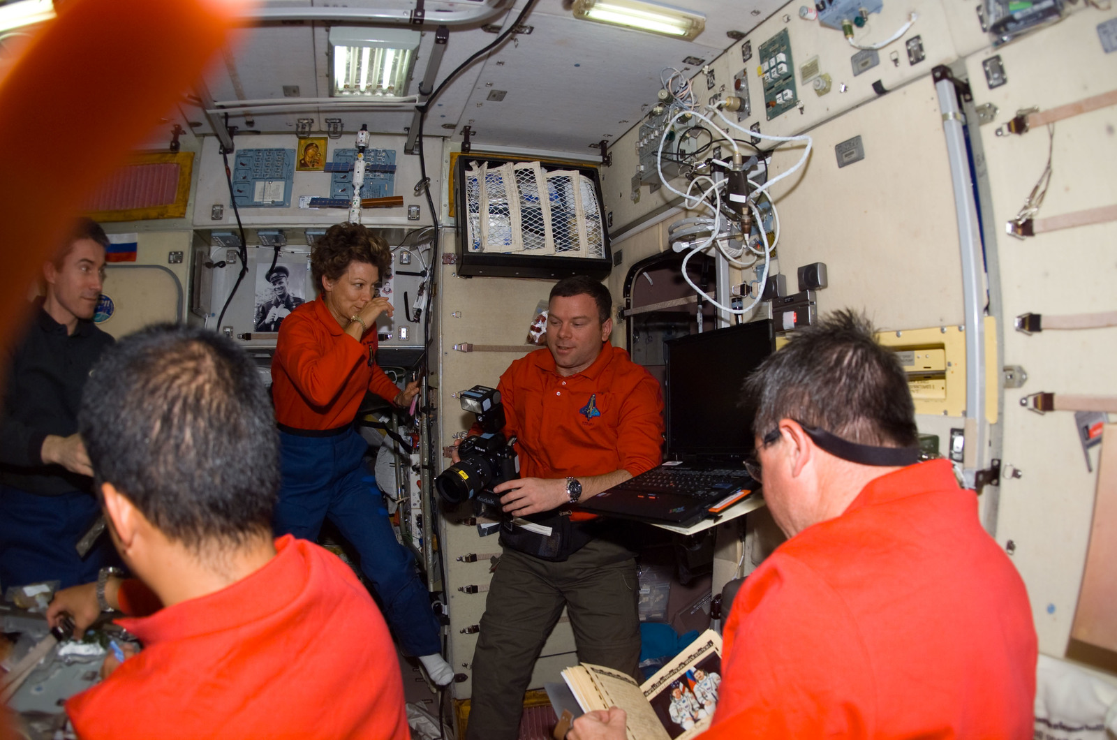 S114E7016 - STS-114 - STS-114 and Expedition 11 crew in Service module
