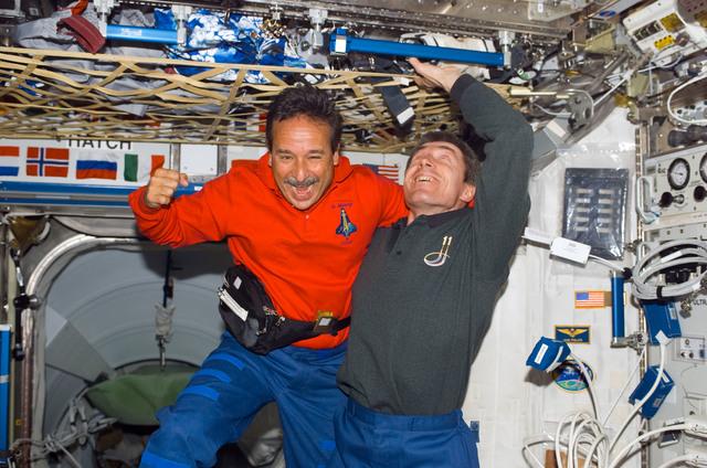 S114E7071 - STS-114 - Camarada and Krikalev inside Node 1