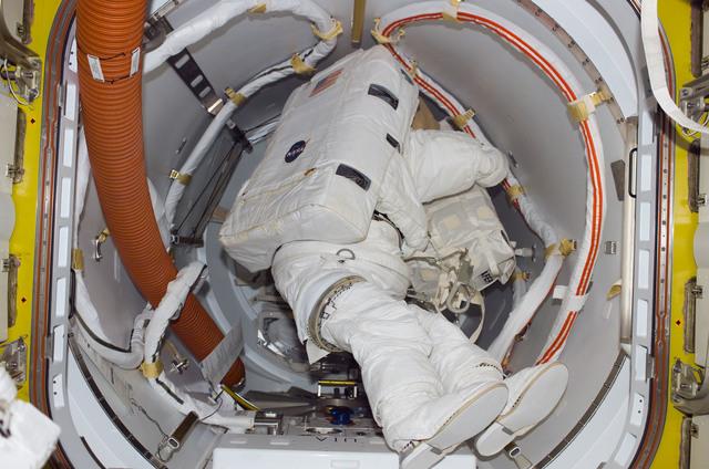 S114E7105 - STS-114 - EMU in Airlock