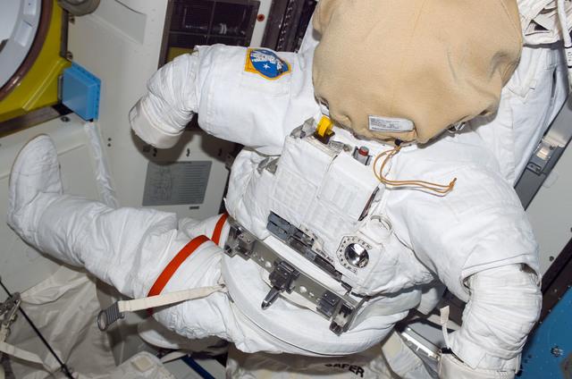 S114E7106 - STS-114 - EMU in Airlock