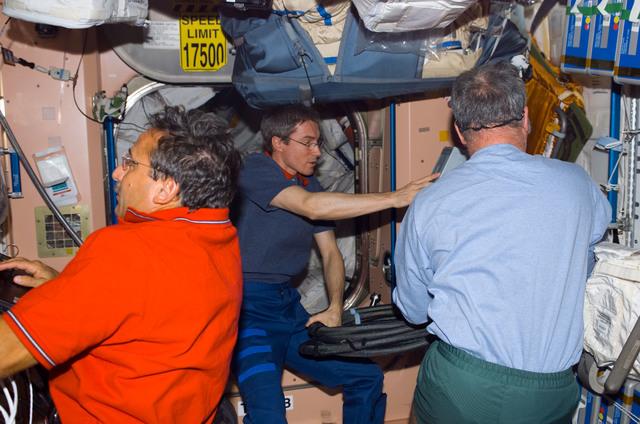 S114E7107 - STS-114 - Crewmembers in Service Module