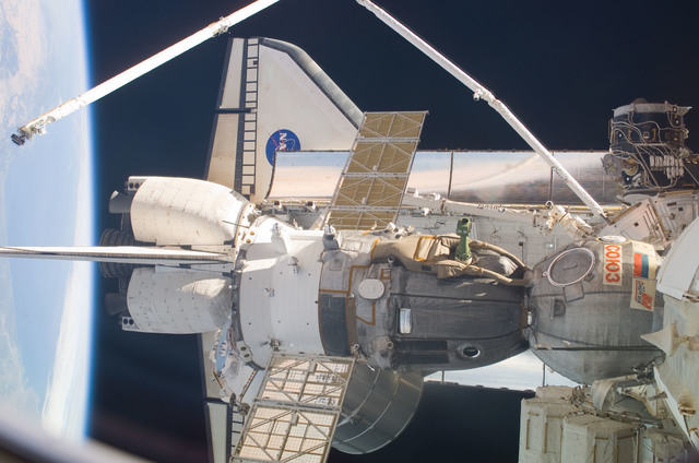 S114E7156 - STS-114 - Shuttle and SSRMS arm