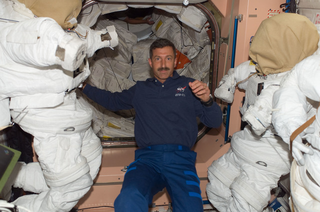 S115E05513 - STS-115 - Burbank poses for photo in the Node 1 during Expedition 13 / STS-115 joint operations