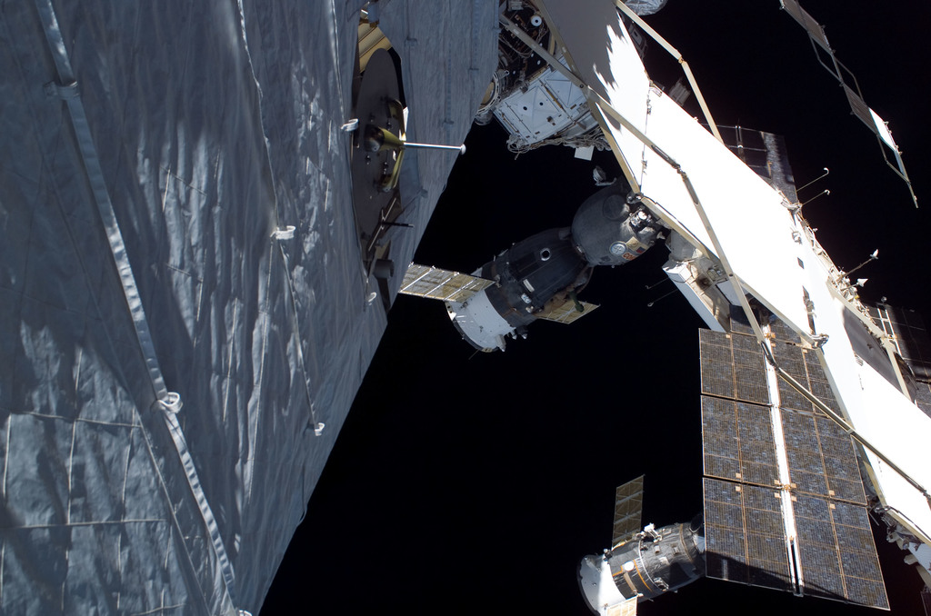 S115E05745 - STS-115 - EVA view of the P1 Truss aft radiator and port side of the P6 Truss and Z1 Truss during STS-115 mission