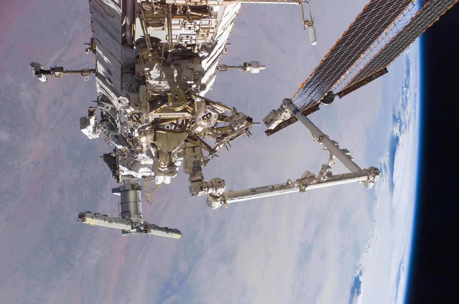 S115E05889 - STS-115 - Burbank and MacLean prepare the SARJ on the P3 - P4 Truss Segment during STS-115 EVA