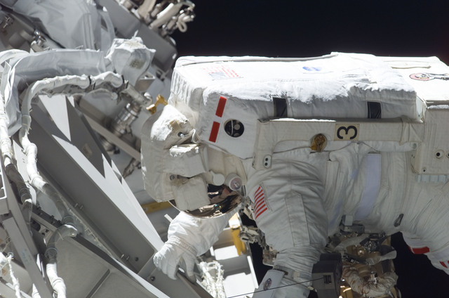 S115E05902 - STS-115 - MacLean prepares the SARJ on the P3 - P4 Truss Segment during STS-115 EVA