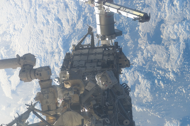 S115E05906 - STS-115 - MacLean and Burbank prepare the SARJ on the P3 - P4 Truss Segment during STS-115 EVA