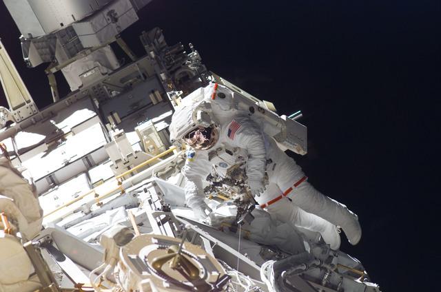 S115E05922 - STS-115 - STS-115 MS Burbank prepares the SARJ on the P3 - P4 Truss Segment during EVA