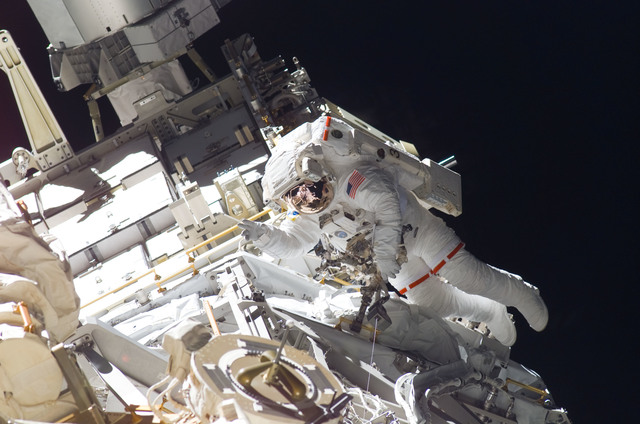 S115E05923 - STS-115 - STS-115 MS Burbank prepares the SARJ on the P3 - P4 Truss Segment during EVA