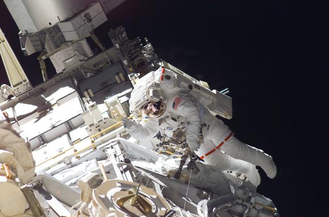 S115E05924 - STS-115 - STS-115 MS Burbank prepares the SARJ on the P3 - P4 Truss Segment during EVA