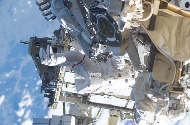 S115E05927 - STS-115 - STS-115 MS Burbank prepares the SARJ on the P3 - P4 Truss Segment during EVA