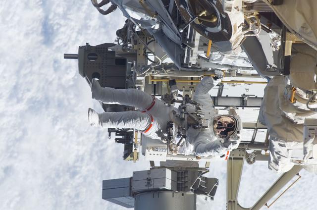 S115E05943 - STS-115 - STS-115 MS Burbank prepares the SARJ on the P3 - P4 Truss Segment during EVA