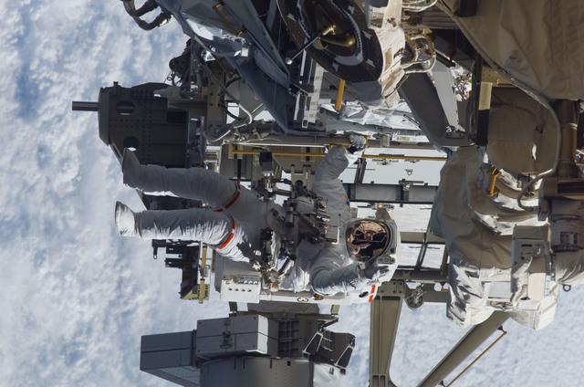 S115E05944 - STS-115 - STS-115 MS Burbank prepares the SARJ on the P3 - P4 Truss Segment during EVA