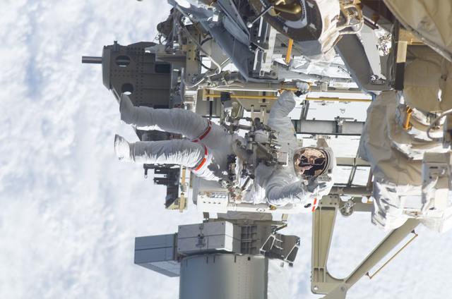 S115E05945 - STS-115 - STS-115 MS Burbank prepares the SARJ on the P3 - P4 Truss Segment during EVA