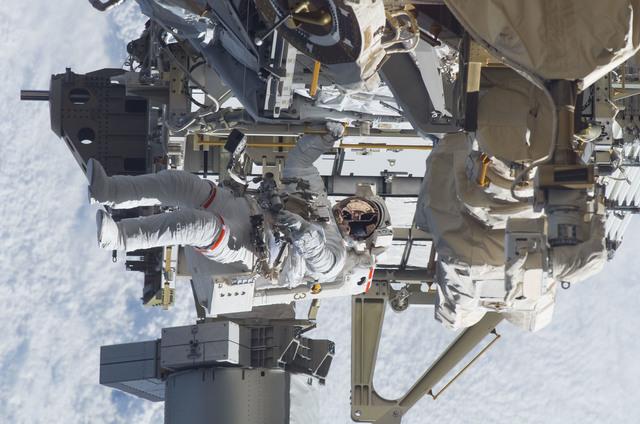 S115E05946 - STS-115 - STS-115 MS Burbank prepares the SARJ on the P3 - P4 Truss Segment during EVA