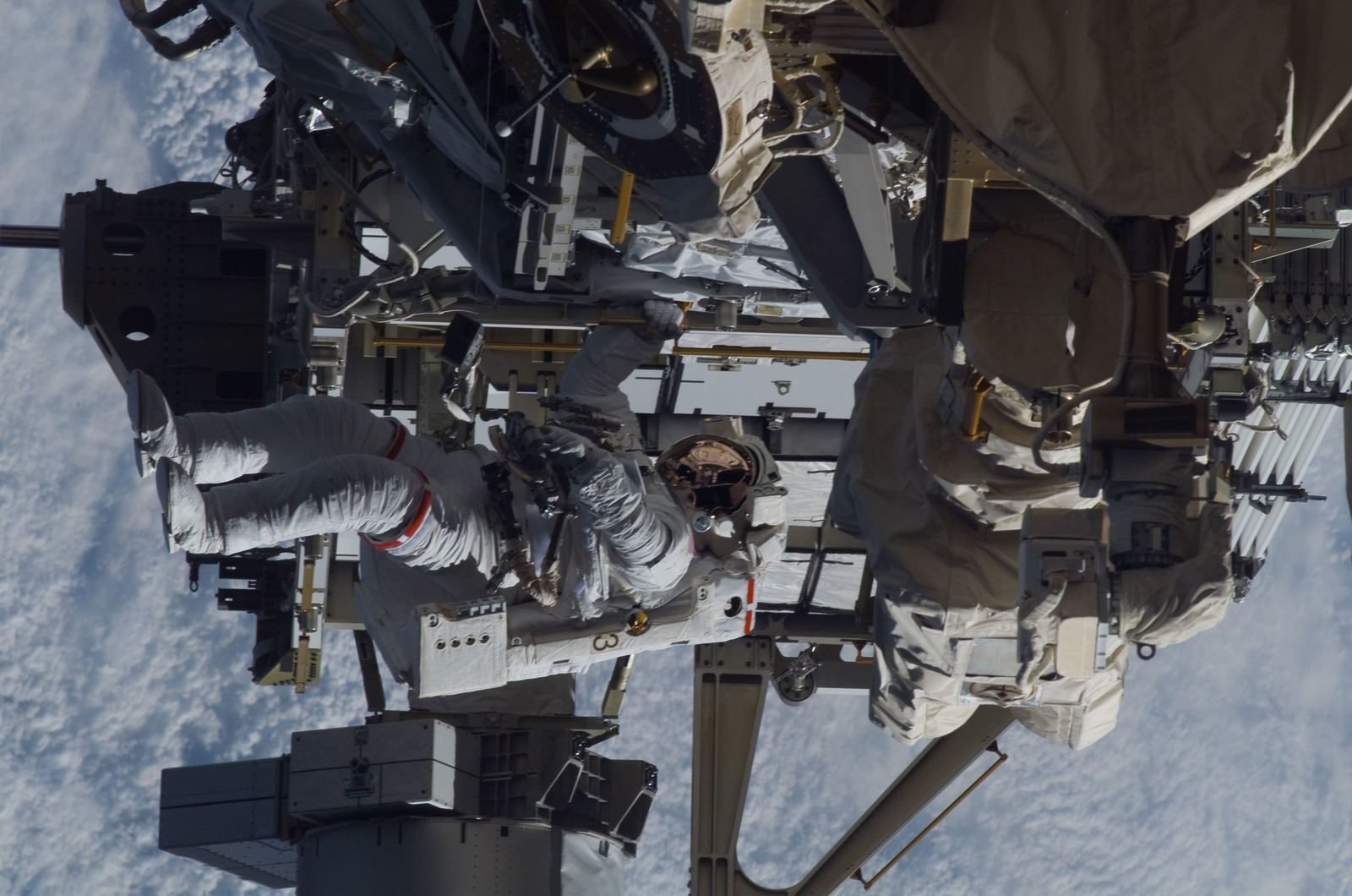 S115E05947 - STS-115 - STS-115 MS Burbank prepares the SARJ on the P3 - P4 Truss Segment during EVA