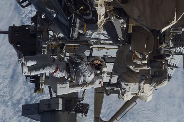S115E05947 - STS-115 - STS-115 MS Burbank prepares the SARJ on the P3 - P4 Truss Segment during EVA