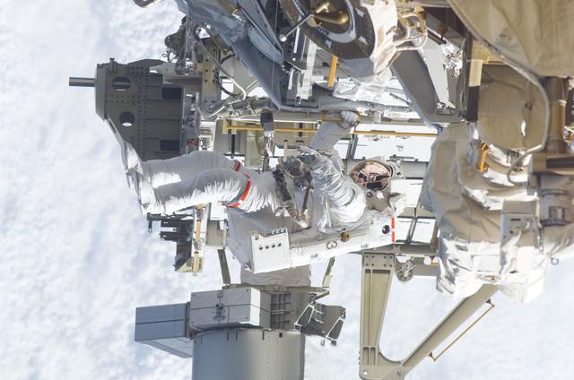 S115E05948 - STS-115 - STS-115 MS Burbank prepares the SARJ on the P3 - P4 Truss Segment during EVA