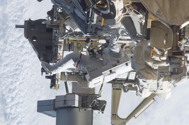 S115E05949 - STS-115 - STS-115 MS Burbank prepares the SARJ on the P3 - P4 Truss Segment during EVA