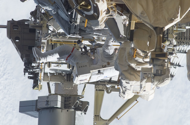 S115E05950 - STS-115 - STS-115 MS Burbank prepares the SARJ on the P3 - P4 Truss Segment during EVA