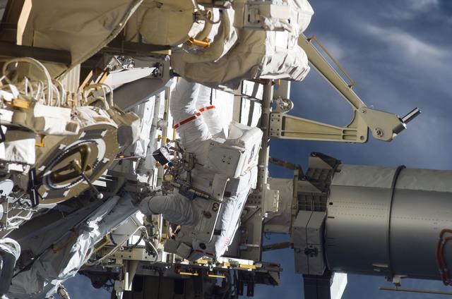 S115E05952 - STS-115 - STS-115 MS Burbank prepares the SARJ on the P3 - P4 Truss Segment during EVA