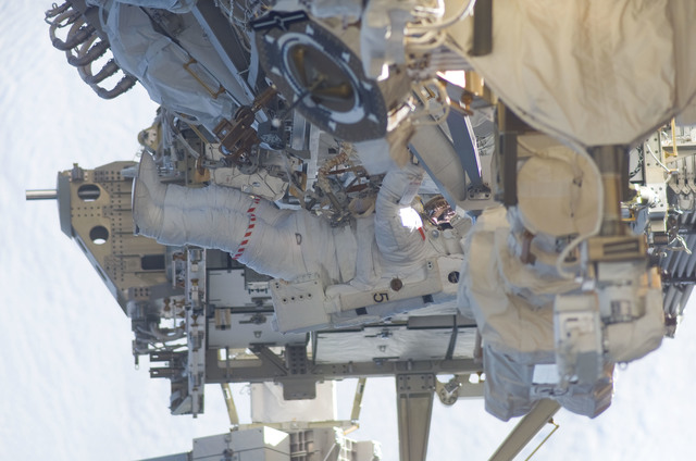 S115E05956 - STS-115 - STS-115 MS MacLean prepares the SARJ on the P3 - P4 Truss Segment during EVA