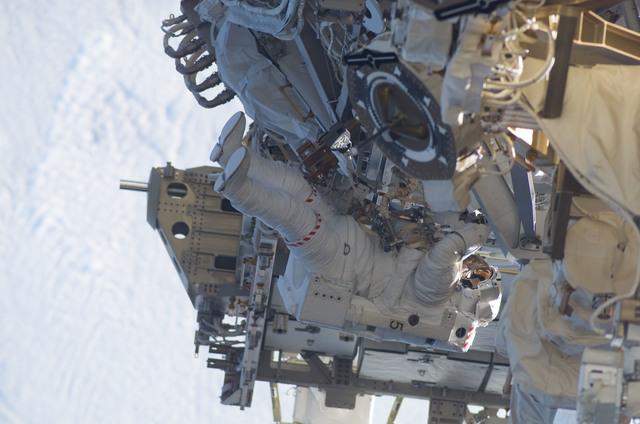S115E05959 - STS-115 - STS-115 MS MacLean prepares the SARJ on the P3 - P4 Truss Segment during EVA