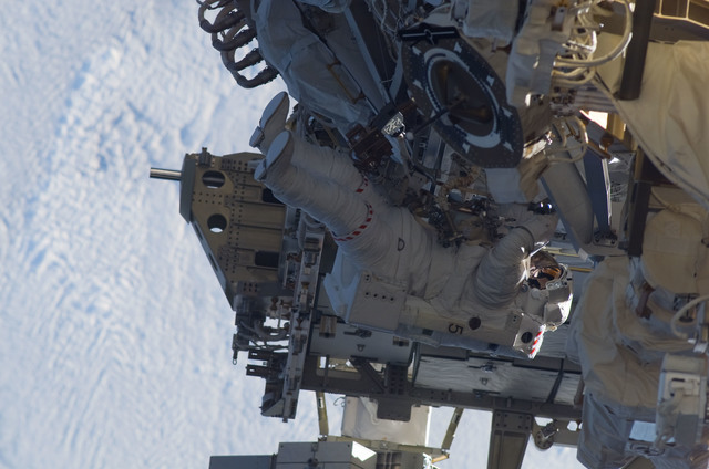S115E05960 - STS-115 - STS-115 MS MacLean prepares the SARJ on the P3 - P4 Truss Segment during EVA