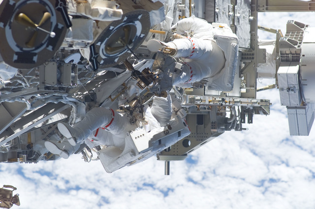 S115E05964 - STS-115 - STS-115 MS Burbank and MacLean prepare the SARJ on the P3 - P4 Truss Segment during EVA