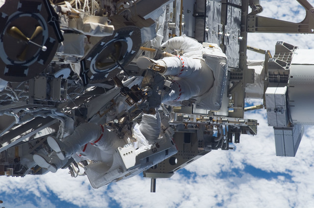S115E05965 - STS-115 - STS-115 MS Burbank and MacLean prepare the SARJ on the P3 - P4 Truss Segment during EVA