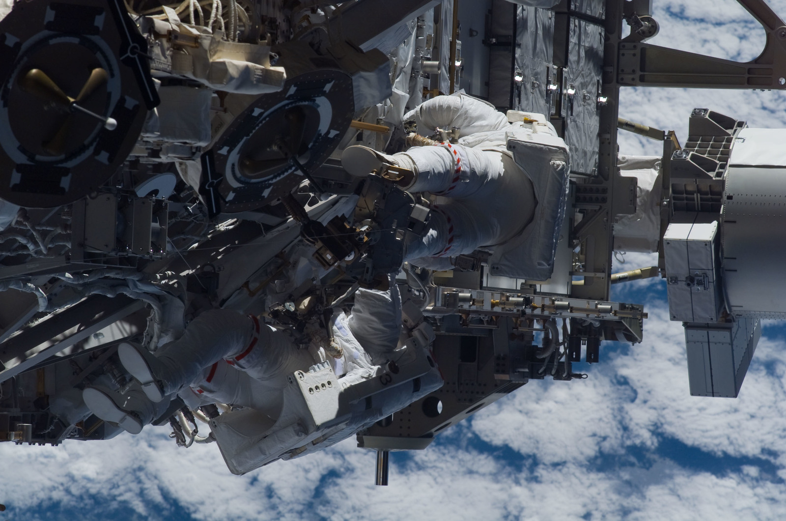 S115E05966 - STS-115 - STS-115 MS Burbank and MacLean prepare the SARJ on the P3 - P4 Truss Segment during EVA