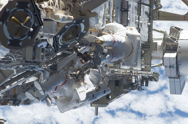 S115E05967 - STS-115 - STS-115 MS Burbank and MacLean prepare the SARJ on the P3 - P4 Truss Segment during EVA
