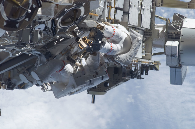 S115E05974 - STS-115 - STS-115 MS Burbank and MacLean prepare the SARJ on the P3 - P4 Truss Segment during EVA