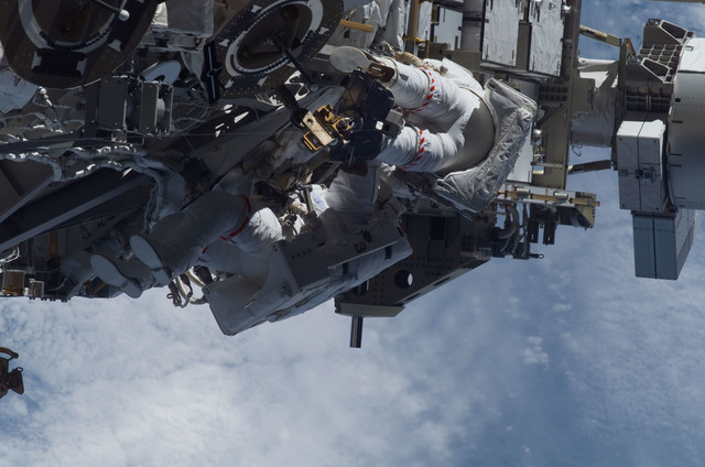 S115E05975 - STS-115 - STS-115 MS Burbank and MacLean prepare the SARJ on the P3 - P4 Truss Segment during EVA