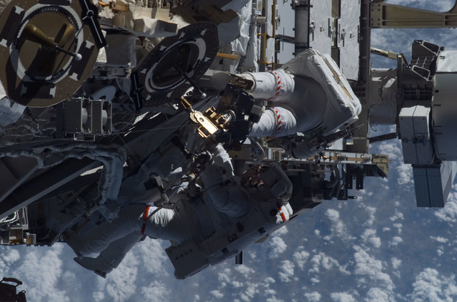 S115E05978 - STS-115 - STS-115 MS Burbank and MacLean prepare the SARJ on the P3 - P4 Truss Segment during EVA