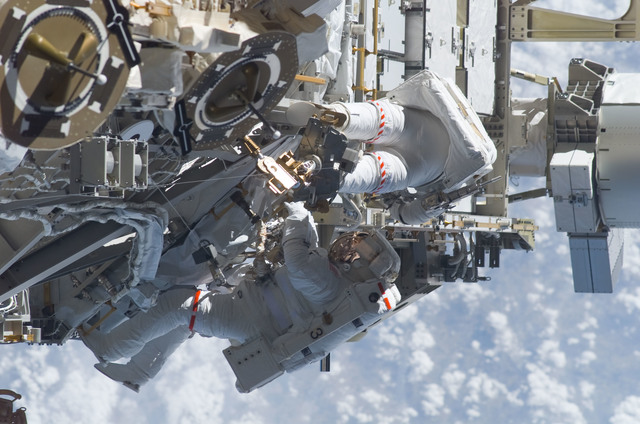 S115E05979 - STS-115 - STS-115 MS Burbank and MacLean prepare the SARJ on the P3 - P4 Truss Segment during EVA