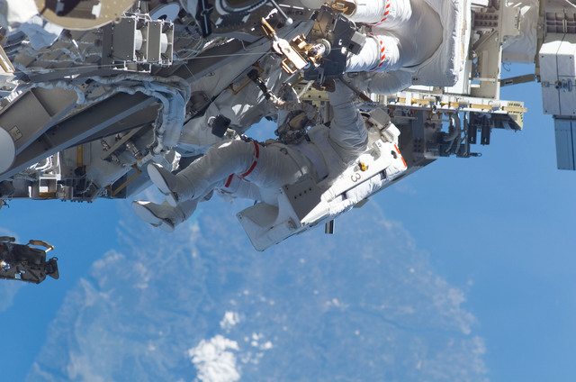 S115E05980 - STS-115 - STS-115 MS Burbank and MacLean prepare the SARJ on the P3 - P4 Truss Segment during EVA